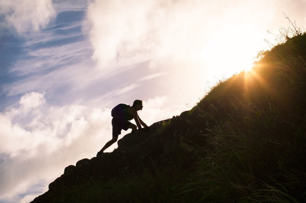 A man is climbing the hill to achieve his goal - Custodian